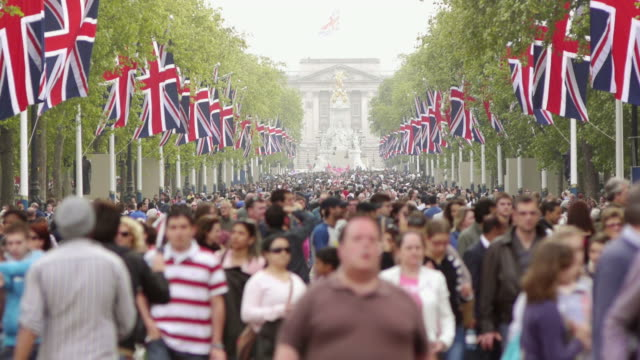 CU T/L Crowd outside Buckingham Palace main gate Royal Wedding Day / London, United Kingdom