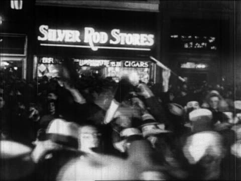 crowd outside of silver rod store in times square at night / new york city / newsreel - 1928 stock videos & royalty-free footage