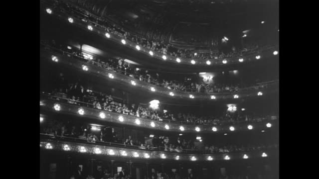 crowd outside the metropolitan opera house on the night of its final gala performance / ticket holders in formal evening wear make their ways passed... - オペラ座点の映像素材/bロール