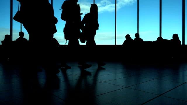 crowd passenger walking in terminal - passenger stock videos & royalty-free footage