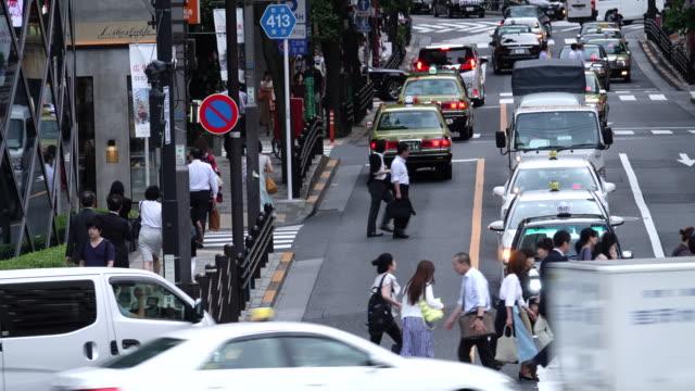 crowd passing crosswalk in tokyo japan.4k time lapse - routine stock videos & royalty-free footage