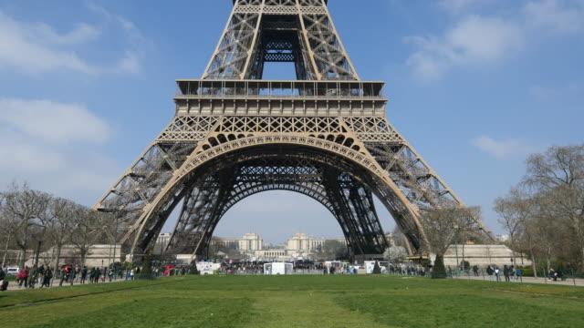 crowd people at eiffel tower in paris - eiffel tower paris stock videos & royalty-free footage