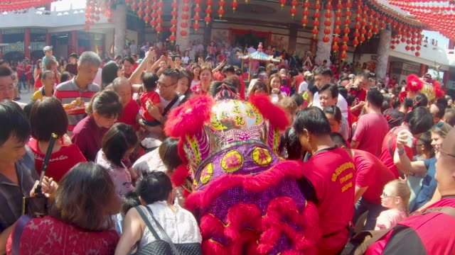 crowd people celebrating chinese new year - kuala lumpur stock videos & royalty-free footage