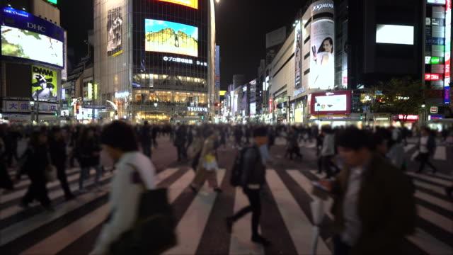 crowd people crossing at night - crossing stock videos & royalty-free footage