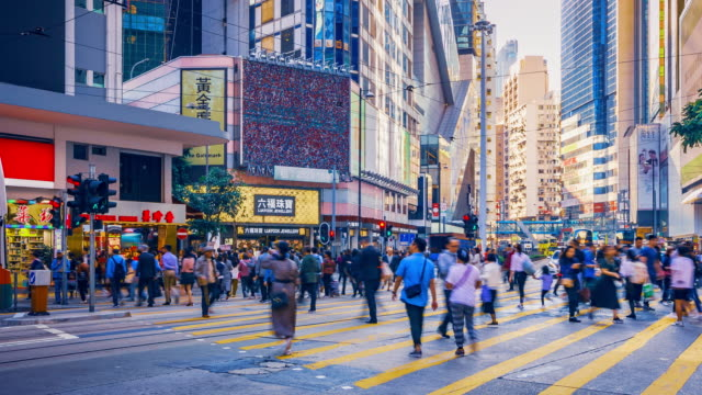 crowd people crossing road in hong kong island, time lapse - crossroad stock videos & royalty-free footage