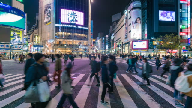 crowd people crossing street at shibuya in tokyo - high speed photography stock videos & royalty-free footage
