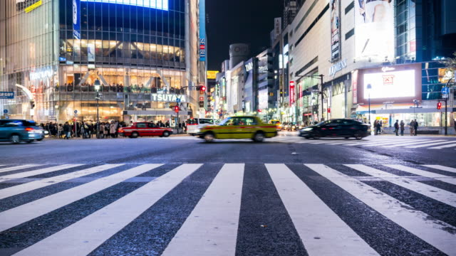crowd people crossing street at shibuya - zebra crossing stock videos and b-roll footage