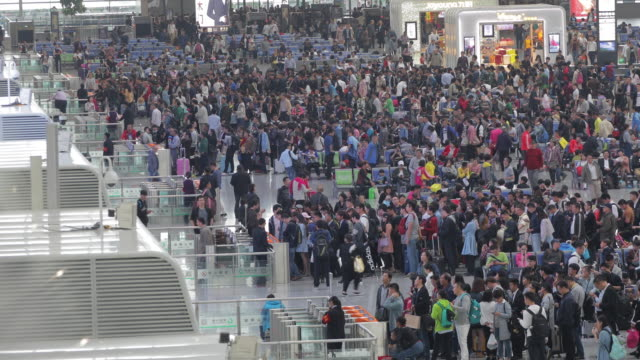 crowd people in modern train station,henan province,china - railway station stock videos & royalty-free footage