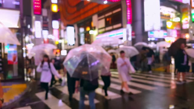 crowd people walking and crossing road in the city while raining - road signal stock videos & royalty-free footage