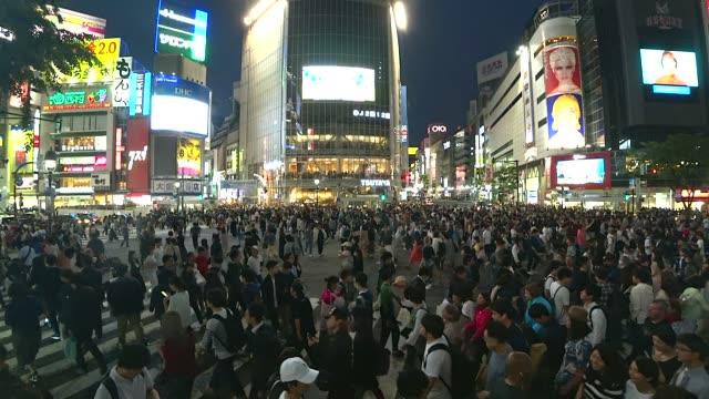 crowd people walking on shibuya crossing road in tokyo,japan - shibuya crossing stock videos & royalty-free footage