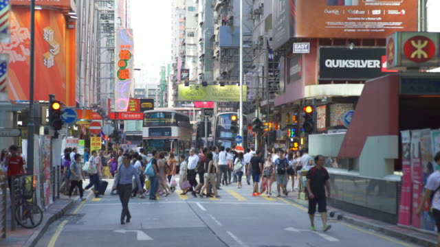 Crowd people walking through a shopping district in Hong Kong