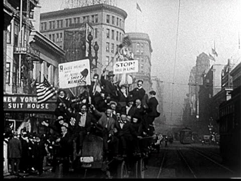 b/w 1918 crowd piled onto truck waving in liberty loan parade / san francisco / newsreel - 1918 stock videos & royalty-free footage