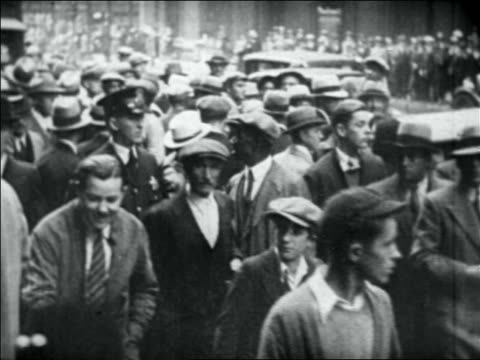 crowd + policeman on city street - 1931 stock videos & royalty-free footage