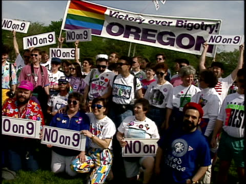 Crowd Posing Under 'Victory Over Bigotry Oregon' Banner and Holding 'No on 9' Signs