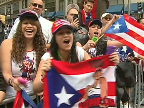 of crowd push-in to puerto rican flag push-out to a crowd cheering with natso. girls wave puerto rico flags for the camera. the puerto rican day... - push in stock videos & royalty-free footage