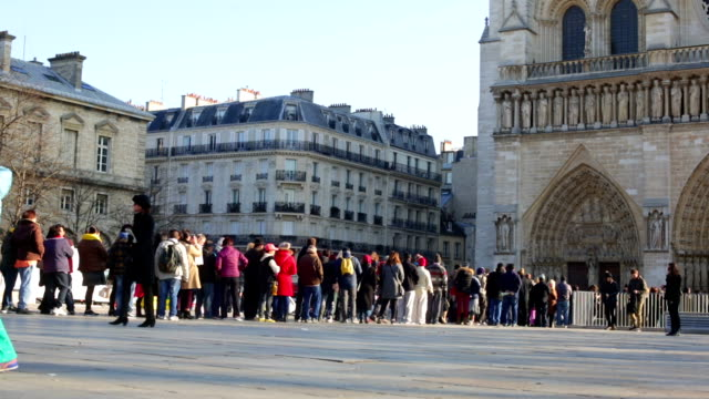 crowd queing at notre dame cathedral paris france - notre dame de paris stock videos and b-roll footage