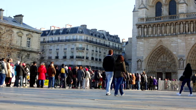 crowd queing at notre dame cathedral paris france - people in a line stock videos & royalty-free footage