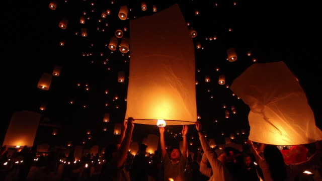 crowd releases sky lanterns, thailand. - south east asia stock videos & royalty-free footage