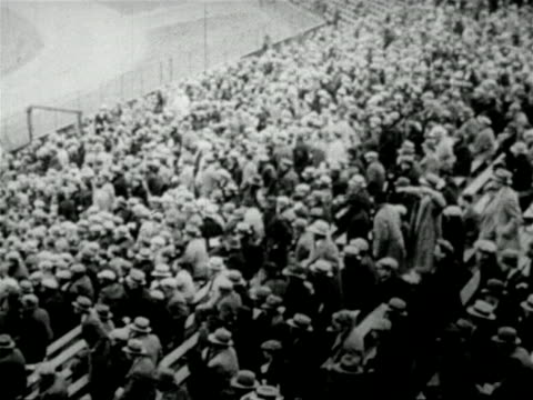 stockvideo's en b-roll-footage met b/w 1927 crowd rising in baseball stadium / newsreel - 1927