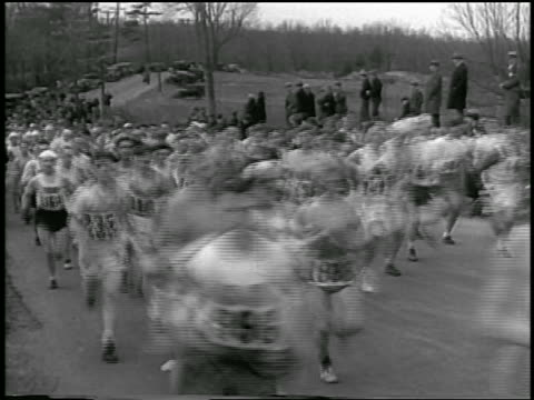 b/w 1933 crowd running on road past camera / boston marathon - 1933 stock videos and b-roll footage