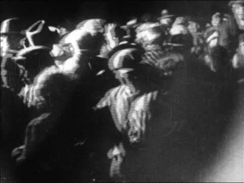 b/w 1927 crowd running to greet lindbergh at le bourget airfield at night / paris / newsreel - 1927 stock videos & royalty-free footage
