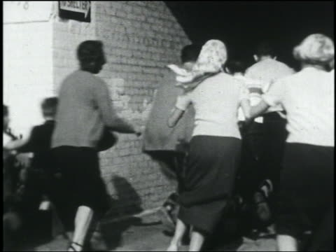 view crowd rushing into building during air raid - crowd running scared stock videos & royalty-free footage