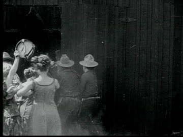 1916 b/w montage ws ms crowd rushing into church, dancing and cheering, scaring parishioners, 1880s / santa monica, california, usa - barn stock videos & royalty-free footage
