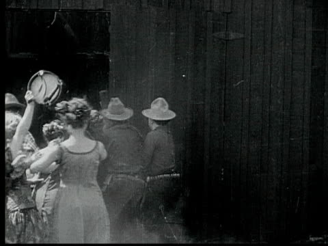 stockvideo's en b-roll-footage met 1916 b/w montage ws ms crowd rushing into church, dancing and cheering, scaring parishioners, 1880s / santa monica, california, usa - boerderijschuur