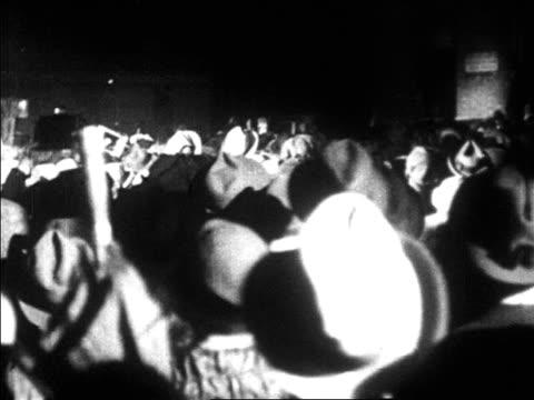 view crowd rushing to greet lindbergh at le bourget airfield / paris / newsreel - 1927年点の映像素材/bロール