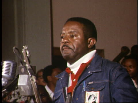 crowd sings at a memphis rally at the conclusion of the sanitation workers' strike; rev. ralph david abernathy prepares to address the crowd. - united states and (politics or government) stock videos & royalty-free footage