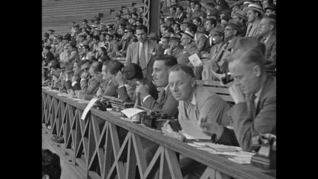 vídeos y material grabado en eventos de stock de crowd sits in stands with palm trees in background during brooklyn dodgers/ny giants baseball game in havana / cuban military officers sit in crowd /... - fan palm tree