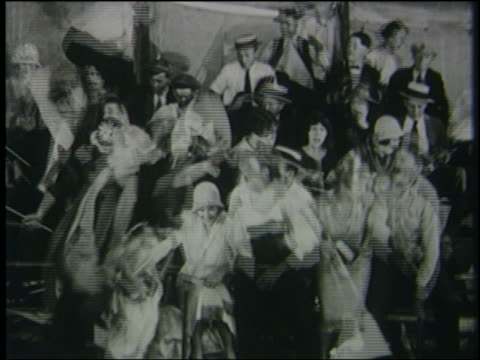 b/w 1926 crowd sitting in bleachers stands up + runs away - 1926 stock videos & royalty-free footage