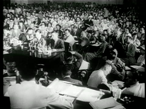b/w 1949 crowd sitting in house committee on unamerican activites hearings / newsreel - 1949 stock videos & royalty-free footage