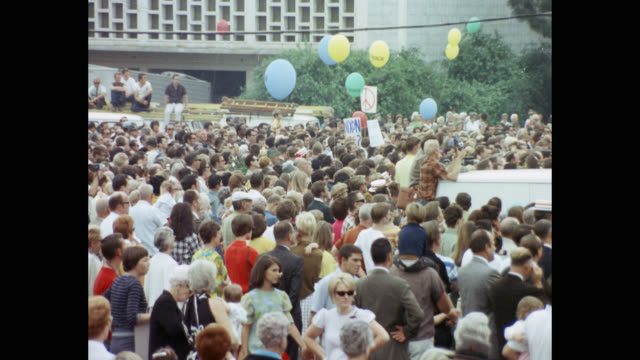 crowd standing with balloons and placards in political rally of richard nixon - baby girls stock videos & royalty-free footage