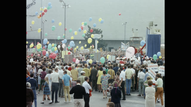 crowd standing with balloons and placards in political rally of richard nixon - unity stock videos & royalty-free footage