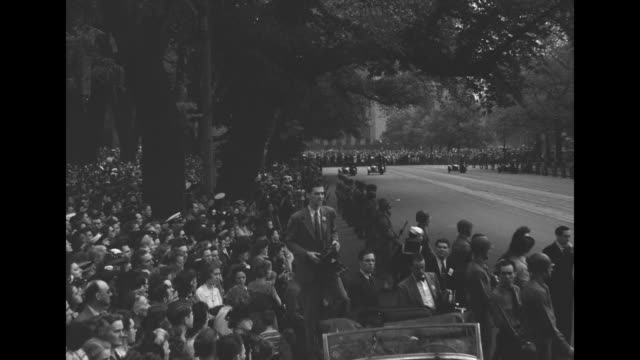 crowd stands along pennsylvania avenue / spectators of pres franklin roosevelt's funeral procession stand near the equestrian statue of gen andrew... - president stock videos & royalty-free footage
