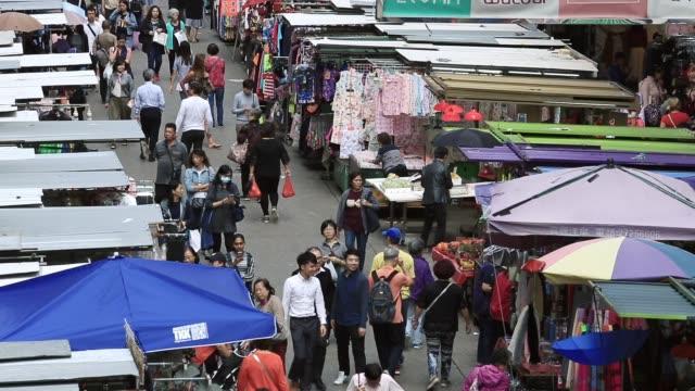 crowd street stroll along mong kok market road in hong kong city - mong kok stock videos & royalty-free footage