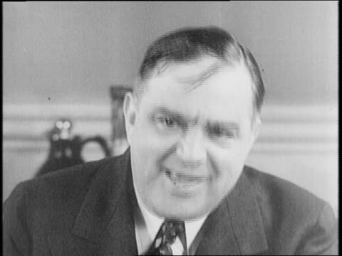 crowd surrounds new york city mayor fiorello la guardia as he arrives at city hall / la guardia shakes hands with politicians upon his reelection to... - fiorello la guardia stock videos & royalty-free footage