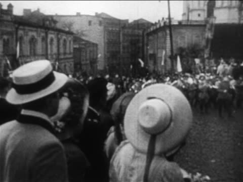 b/w 1904 crowd throwing flowers to russian soldiers marching on street / russojapanese war / doc - 1904 stock videos & royalty-free footage
