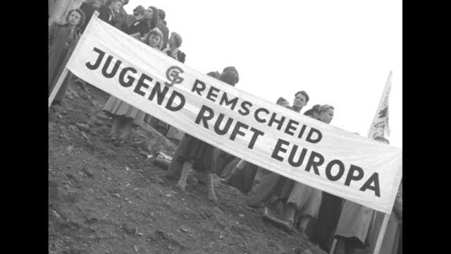 'Delegiertentag der Jugend and Rhein und Ruhr 1950 Berlin 15 Oktober 1950' and in stadium grandstands behind / 'Remscheid Jugend Ruft Europa' / young...