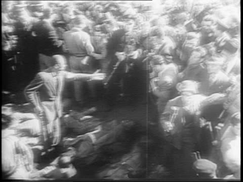 crowd views the unveiling of iwo jima statue in nyc / large crowd in italy / crowd charges to see body of benito mussolini / mussolini and mistress... - benito mussolini stock videos & royalty-free footage