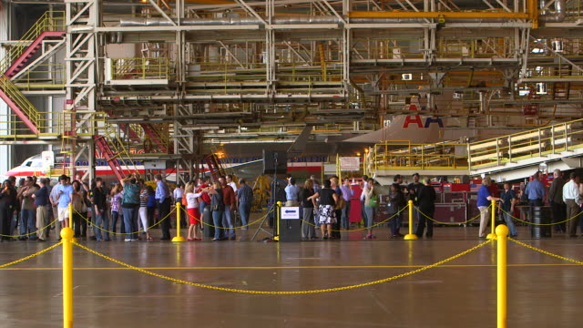 crowd waiting for arrival of dreamliner aircraft in hanger/dfw international airport, dallas-fort worth, texas, usa - dallas fort worth airport stock videos & royalty-free footage