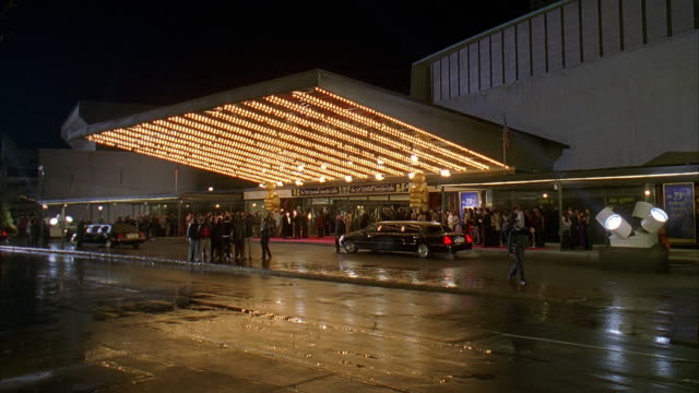ws crowd waiting outside hummingbird centre entrance as limousine arrives at night / toronto, canada  - premiere stock videos & royalty-free footage