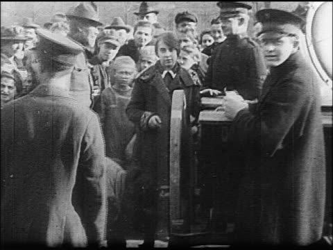 pan crowd waiting to get food from government / german revolution / documentary - 1918 stock videos and b-roll footage