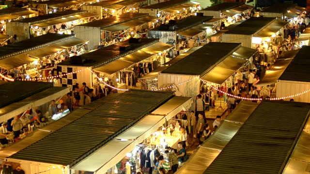 crowd walk on market in container in Thailand at night