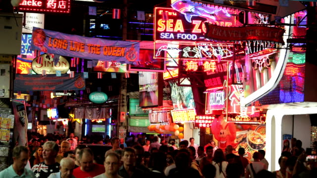 crowd walk through the walking street in pattaya, thailand. - pattaya stock videos & royalty-free footage