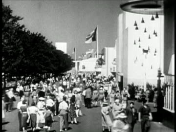 crowd walking around at new york world's fair / travelogue - new york world's fair stock videos & royalty-free footage
