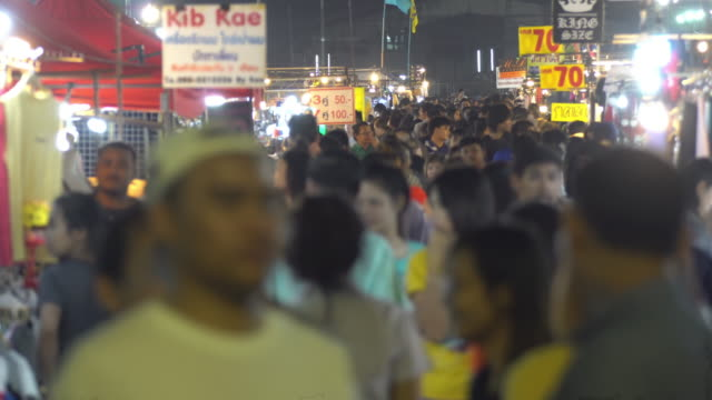 crowd walking at night market - south east asia stock videos & royalty-free footage