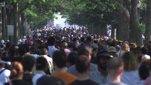 crowd walking away in park - artbeats stock videos & royalty-free footage