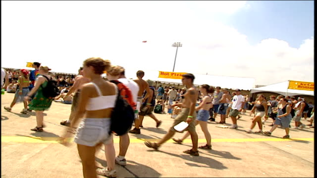 of crowd walking by food stands at woodstock '99 - 1999 stock videos & royalty-free footage